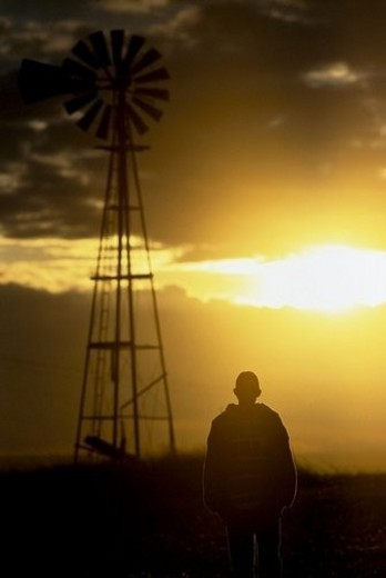 Man standing by a windmill : Stock Photo