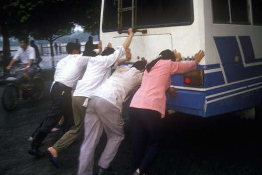 Stock Photo: 4029R-70454 People pushing bus in Guilinina