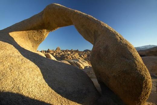 Stock Photo: 4029R-71804 The Alabama Hills Arch at sunrise near Lone Pine