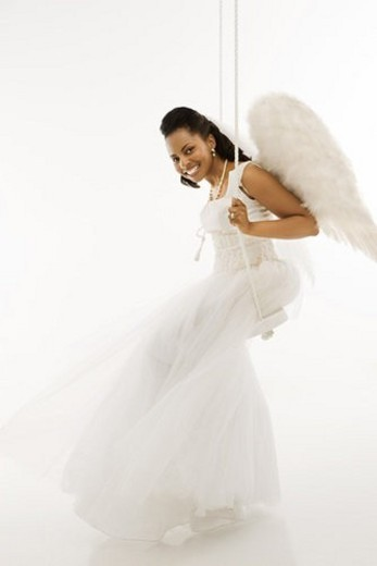 Angelic Mid-adult African-American bride swinging. : Stock Photo