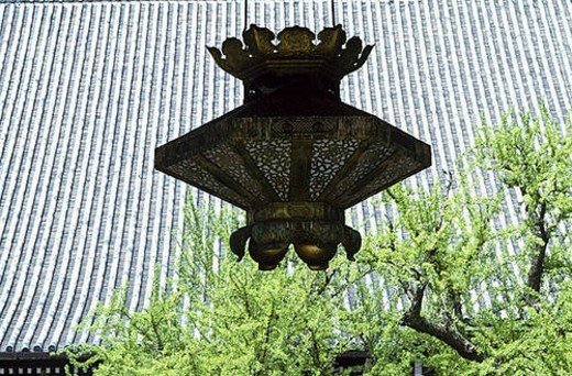 Garden Lantern and tiled roof : Stock Photo