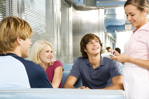 Group of friends ordering food in a diner : Stock Photo
