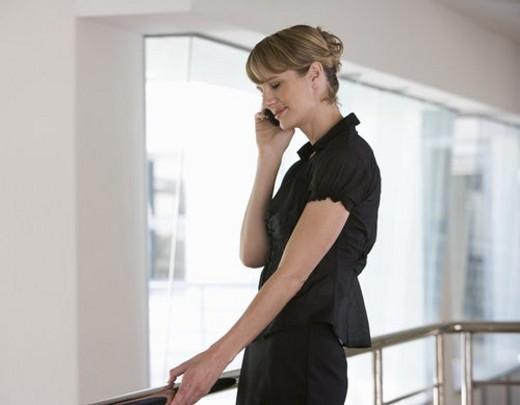 Stock Photo: 4029R-79756 A businesswoman using a mobile phone