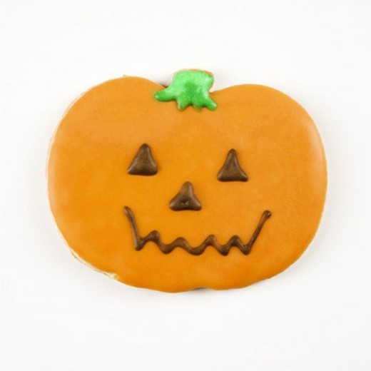 Sugar cookie in shape of jack o lantern with decorative icing. : Stock Photo