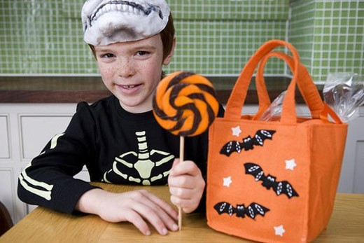 Little boy with trick or treat sweets : Stock Photo