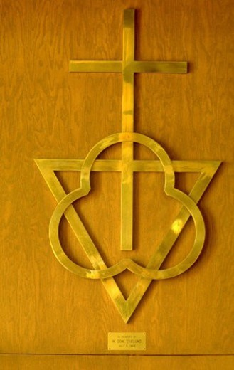 Trinity and Cross metal sculpture on wall : Stock Photo