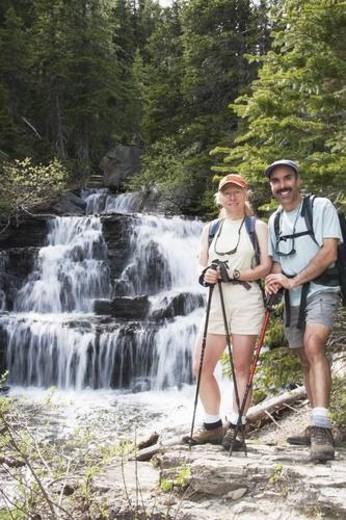Stock Photo: 4029R-83614 Couple hiking near a waterfall