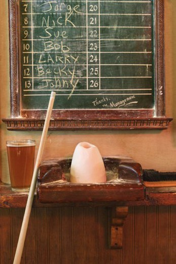 Chalkboard queue for people waiting to play billiards in nightclub with chalk and pool stick. : Stock Photo