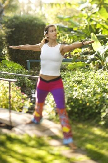 Caucasian mid-adult woman practicing yoga. : Stock Photo