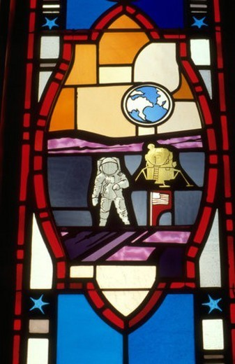 Neil Armstrong walking on moon stained glass window : Stock Photo