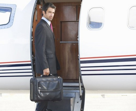 Stock Photo: 4029R-88909 A businessman boarding a plane