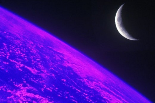 Stock Photo: 4029R-9157 The edge of Earth viewed from space with a crescent moon against a black sky