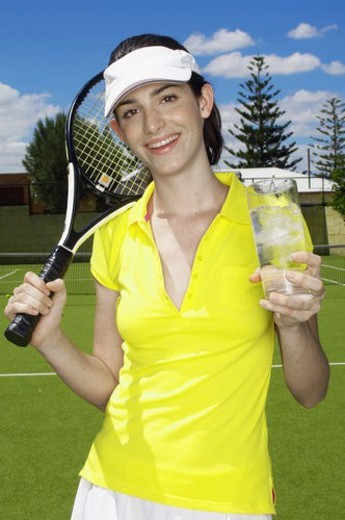 Female tennis player drinking icy water (portrait) : Stock Photo