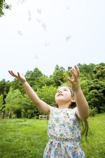 The Girl Who Throws Feather : Stock Photo
