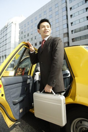 Stock Photo: 4029R-97388 Man is stepping out of car, portrait