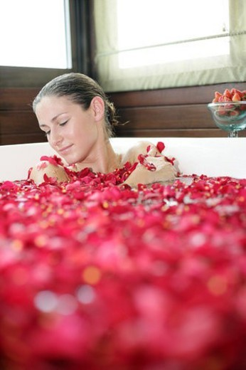 A young woman having aromatherapy bath. : Stock Photo