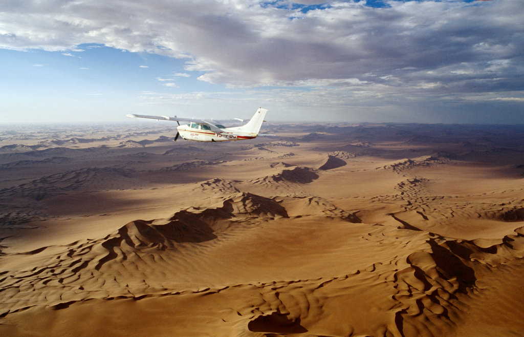 Stock Photo: 4030-1450 Plane Flying Over Namib Desert, Namibia, Africa