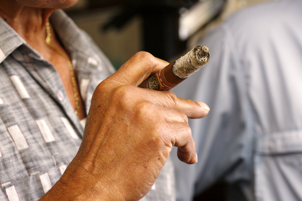 Man Smoking Cigar, Cuban Crafters, Miami : Stock Photo