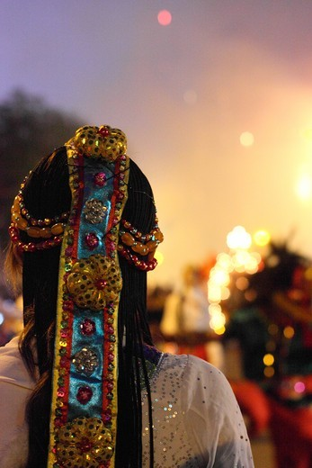 Stock Photo: 4031-242 Temple dancer watching fireworks during celebration, Tainan, Taiwan