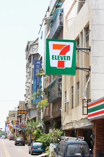 Buildings along a street, 7-Eleven, Tainan, Taiwan : Stock Photo