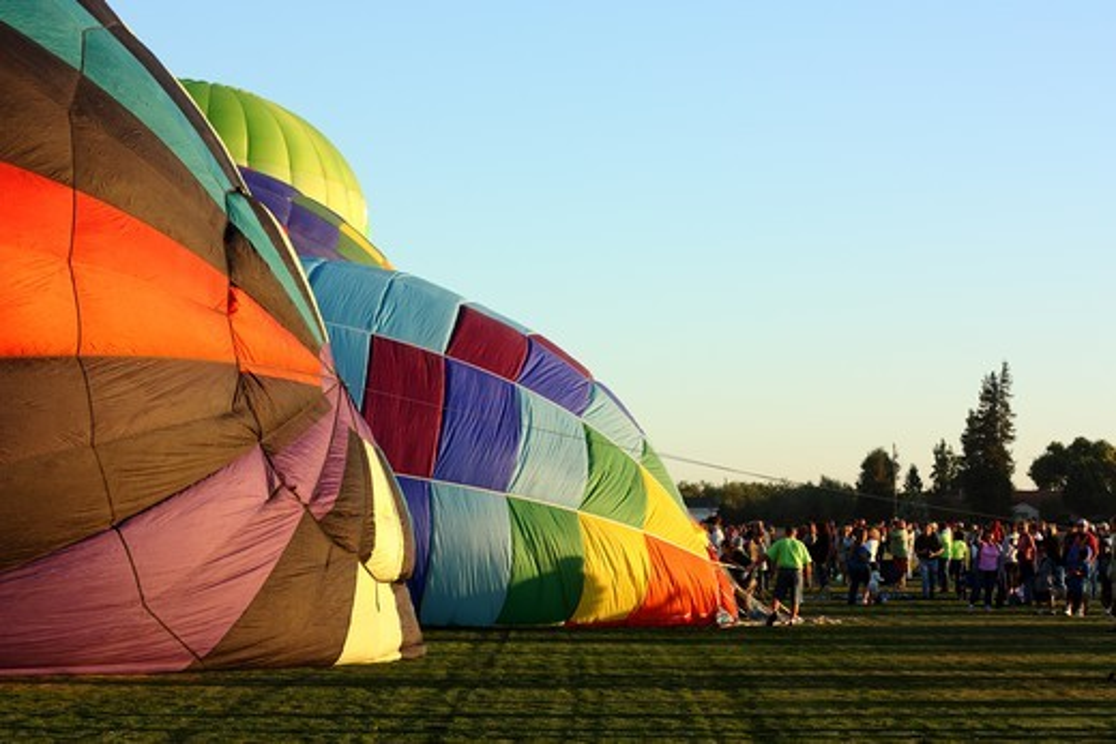 USA, California, Ripon, Spectators watching hot air balloon inflation at Color the Skies Hot Air Balloon Festival : Stock Photo