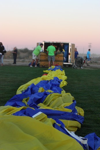 USA, California, Ripon, Crew members assembling hot air balloon at Color the Skies Hot Air Balloon Festival : Stock Photo