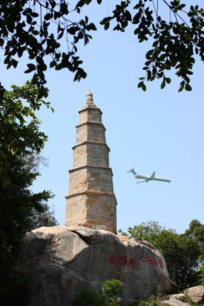 Taiwan, Kinmen County, Kinmen National Park, Kinmen City, Wentai Pagoda with passenger jet descending to land at airport : Stock Photo