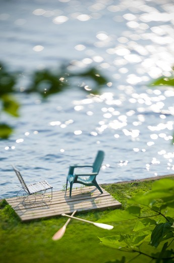 Stock Photo: 4033-117 Two chairs and oars at the lakeside, Ithaca, New York State, USA