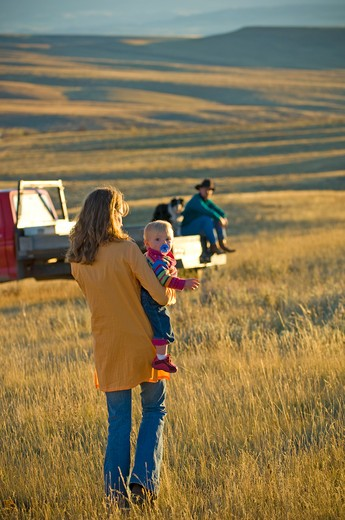 Family with a dog and a pick-up truck in a field, Montana, USA : Stock Photo