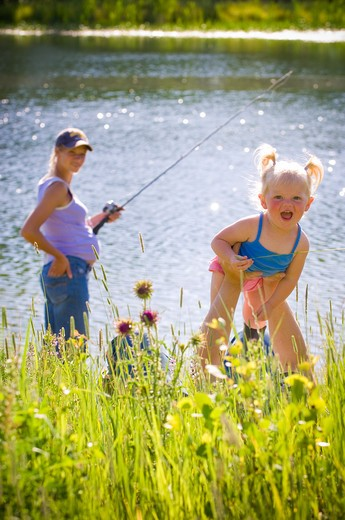 Family fishing in a lake, Bozeman, Gallatin County, Montana, USA : Stock Photo
