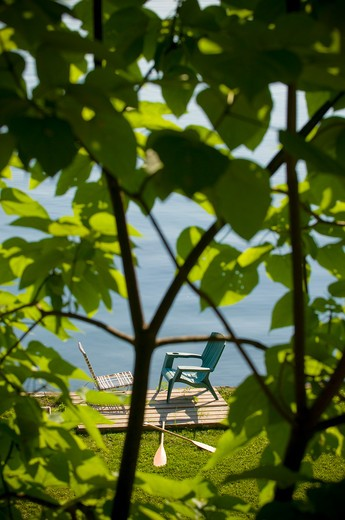 Stock Photo: 4033-178B Two chairs and oars at the lakeside viewed from the branches of a tree, Ithaca, New York State, USA