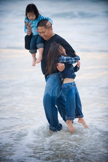 Mid adult man enjoying with his daughters on the beach, La Jolla, California, USA : Stock Photo