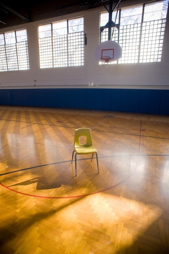 Stock Photo: 4033-288 Empty chair in a high school basketball court, Bozeman, Montana, USA