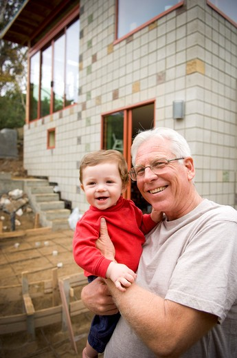 Senior man holding his grandson, San Diego, California, USA : Stock Photo