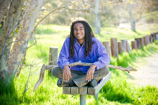 Stock Photo: 4033-339B Young man sitting on a park bench, San Diego, California, USA
