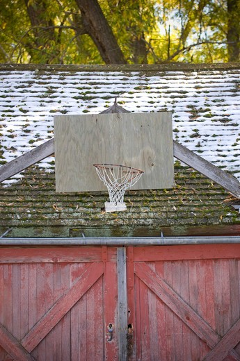 Barn with basketball hoop and snow, Bozeman, Montana, USA : Stock Photo
