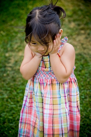 Close-up of a girl looking afraid, San Diego, California, USA : Stock Photo