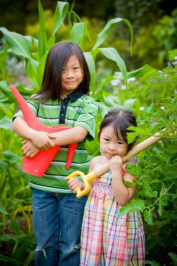 Stock Photo: 4033-364 Boy and his sister with gardening equipment, San Diego, California, USA