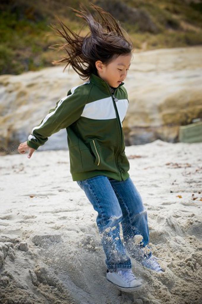 Boy jumping on sand on the beach, San Diego, California, USA : Stock Photo
