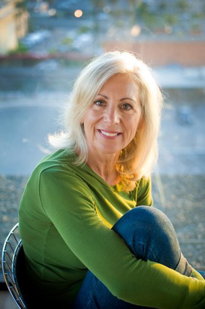 Portrait of a senior woman smiling, San Diego, California, USA : Stock Photo