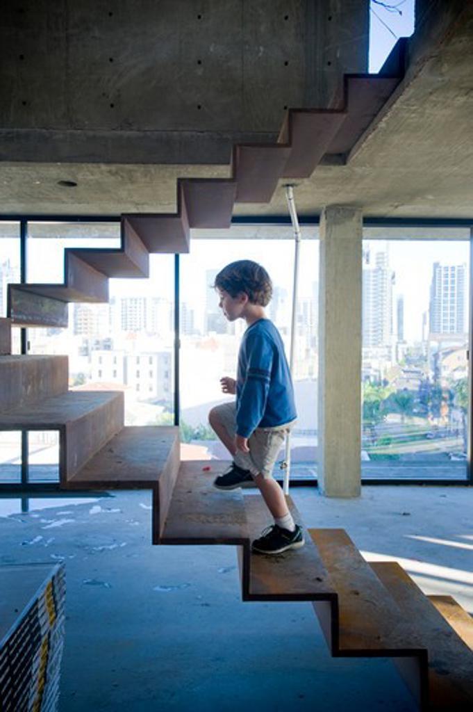 Boy walking up stairs, San Diego, California, USA : Stock Photo