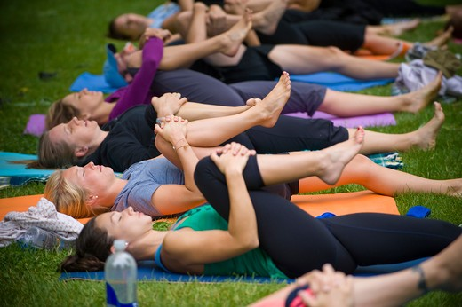 Group of people practicing yoga in a park, San Diego, California, USA : Stock Photo