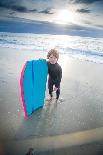 Boy with a bodyboard on the beach, San Diego, California, USA : Stock Photo