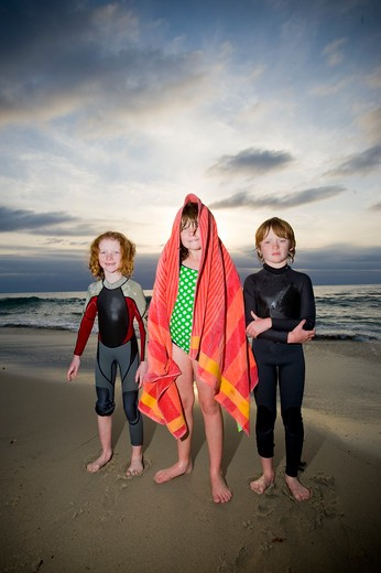 Children standing on the beach, San Diego, California, USA : Stock Photo