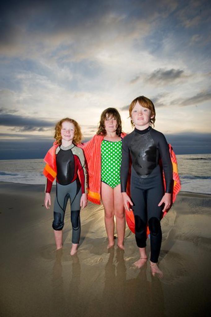 Children standing on the beach, San Diego, California, USA : Stock Photo