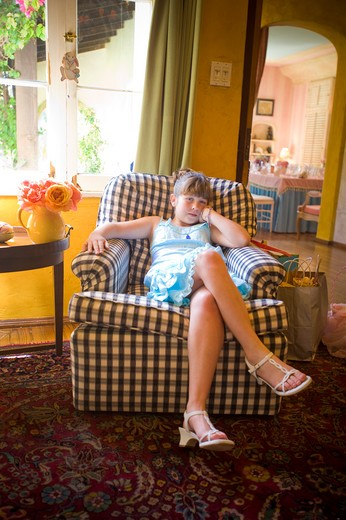 Portrait of a girl sitting in an armchair, San Diego, California, USA : Stock Photo
