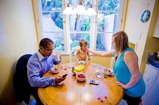 Family at the breakfast table : Stock Photo
