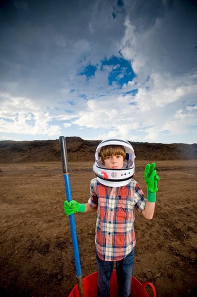 Boy imitating an astronaut : Stock Photo