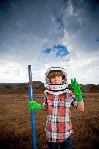 Stock Photo: 4033-425B Boy imitating an astronaut