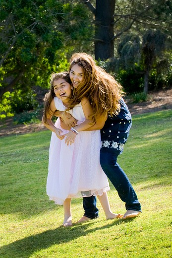 Stock Photo: 4033-441 Mid adult woman playing with her daughter in a park